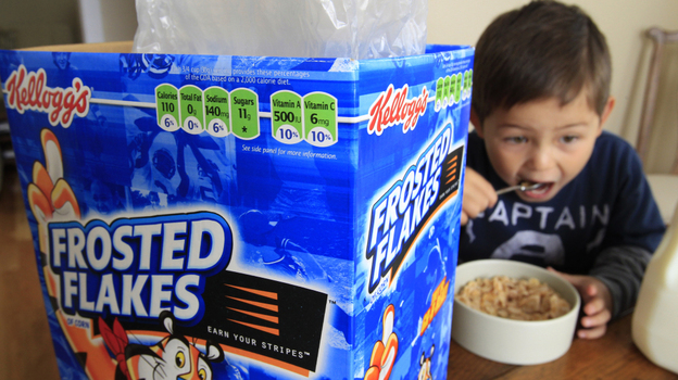 Nathaniel Donaker, 4, eats Kellogg's Frosted Flakes cereal at his home in Palo Alto, Calif. Frosted Flakes is 27 percent sugar, according to a report by the Environmental Working Group. (AP)