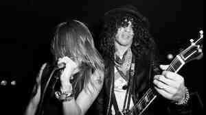 Axl Rose and Slash sharing the stage in 1985. Will they