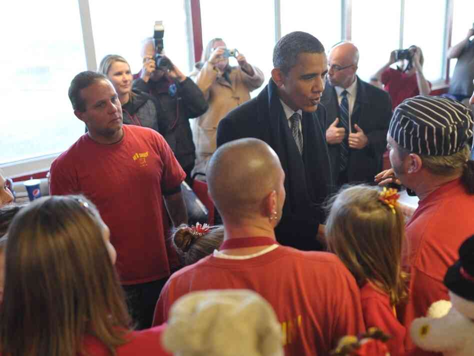 President Barack Obama chats with the staff of the 'We B Smokin' BBQ restaurant after he spoke at Osawatomie High School Dec. 6, 2011 in Osawatomie, Kansas.