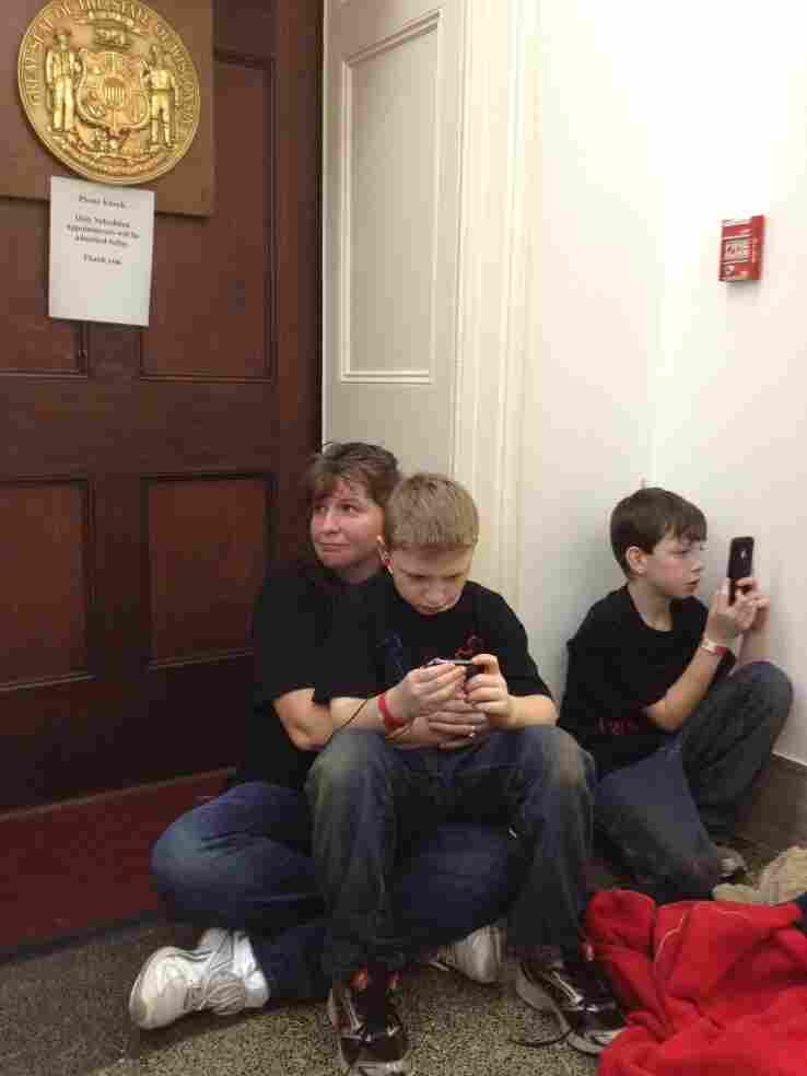 Kelley Albrecht of Wisconsin sat with her two sons outside Rep. Paul Ryan's office on Tuesday.