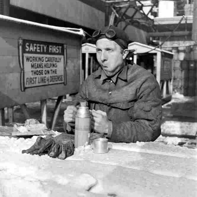 As the Japanese navy grew during the '30s, ships were transferred from Brooklyn to the Pacific to deal with the potential threat, which created more jobs in shipbuilding. Shown here is a worker on break at the Brooklyn Navy Yard.