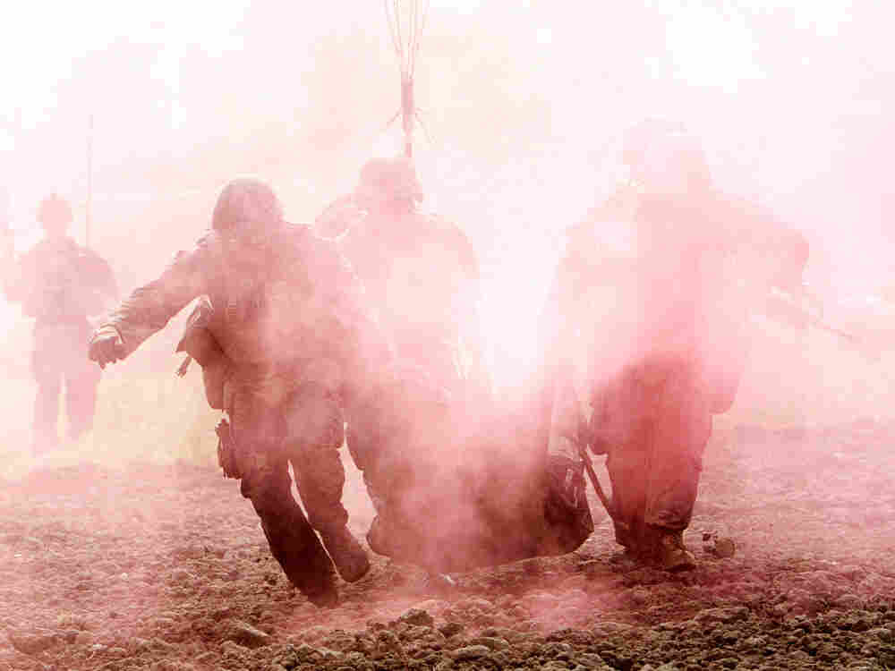 "US Marines carry a wounded comrade who has been hit by an Improvised Explosive Device (IED) to a Medevac helicopter of U.S. Army's Task Force Lift ""Dust Off"", Charlie Company 1-171 Aviation Regiment in Helmand province on November 10, 2011."