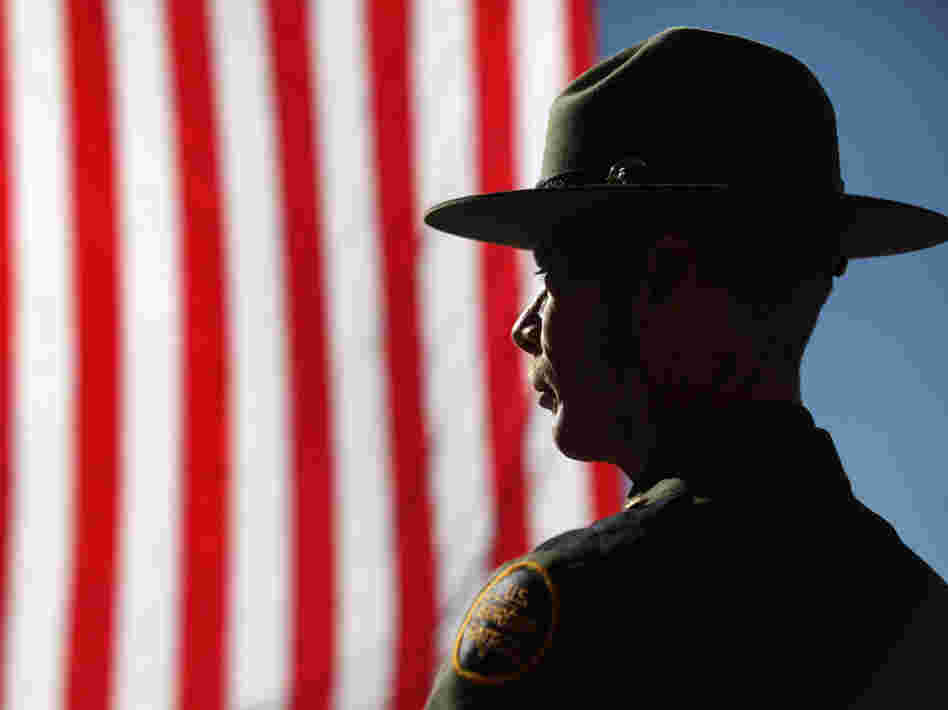 "Border Patrol agent Michael Wagenen attends a memorial service for slain comrade Brian Terry, who was killed during a shootout near the U.S.-Mexico border last year. His death pushed Congress to investigate ""Fast and Furious"" when two guns linked to the program were found near Terry's body."