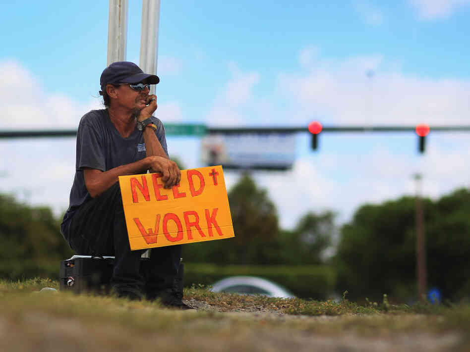 Stephen Greene works a street corner hoping to land a job as a laborer or carpenter on June 3, 2011 in Pompano Beach, Florida.
