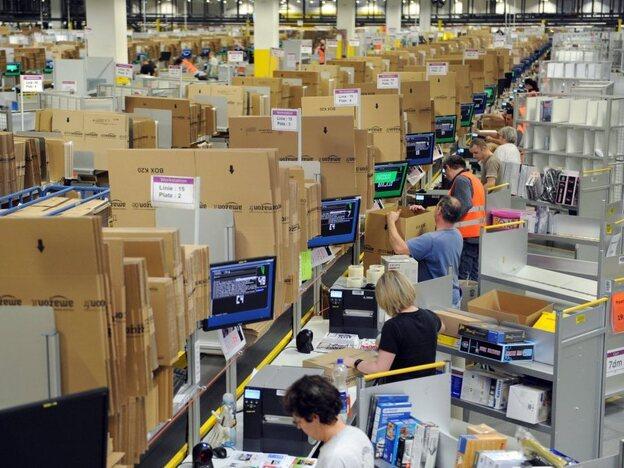 Employees pack goods at a logistics center in Bad Hersfeld, Germany. (EPA /Landov)
