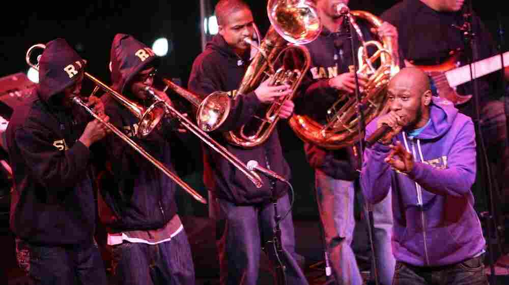 Rapper Mos Def performs with his big band project, an ensemble with traditional jazz instrumentation.