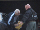 Former Penn State assistant football coach Jerry Sandusky, center, gets out of a car in front of his home on Thursday after he was released from jail.
