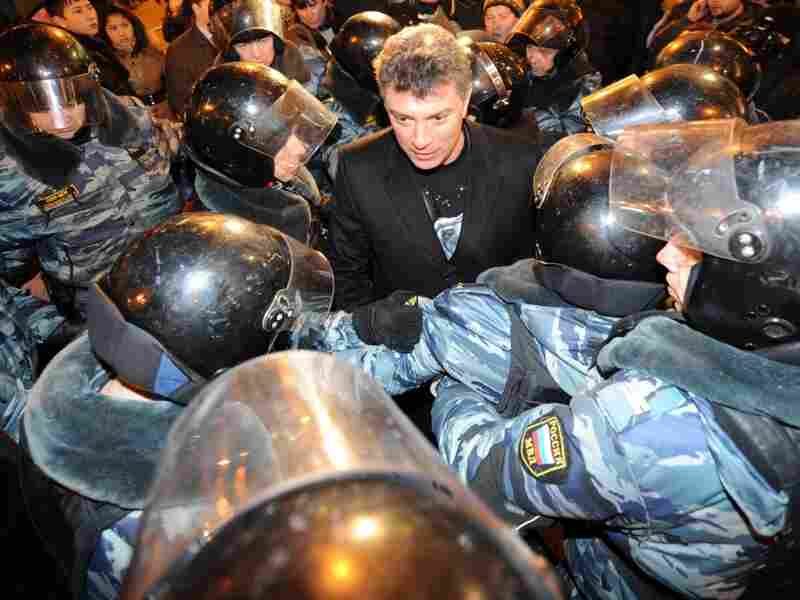Riot police encircle Russian opposition leader Boris Nemtsov, detained while taking part in an unauthorized rally, on Triumfalnaya Square in central Moscow, on Dec. 6, 2011.