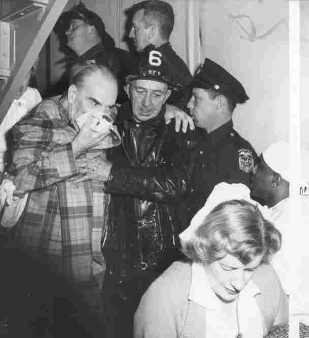 A fireman helps an elderly patient down a stairwell. That day, 782 patients were in the hospital. Those who were not well enough to be sent home were transferred to undamaged floors or other hospitals.