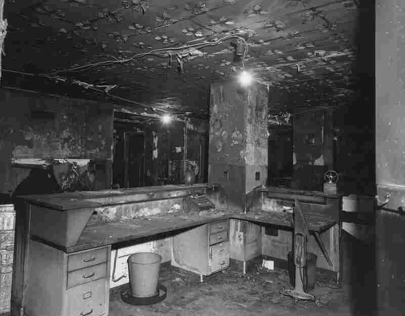 A nurses' station ravaged by the fire. Flammable ceiling tiles fed the blaze, and hospital building codes around the nation were changed as a result.