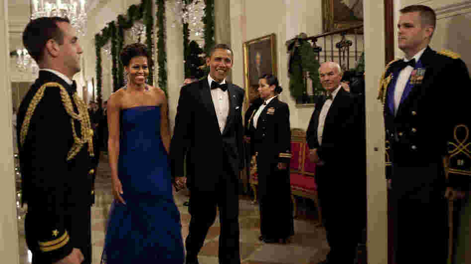 For a formal gathering, Michelle Obama demonstrates her sophistication in this elegant deep blue gown.