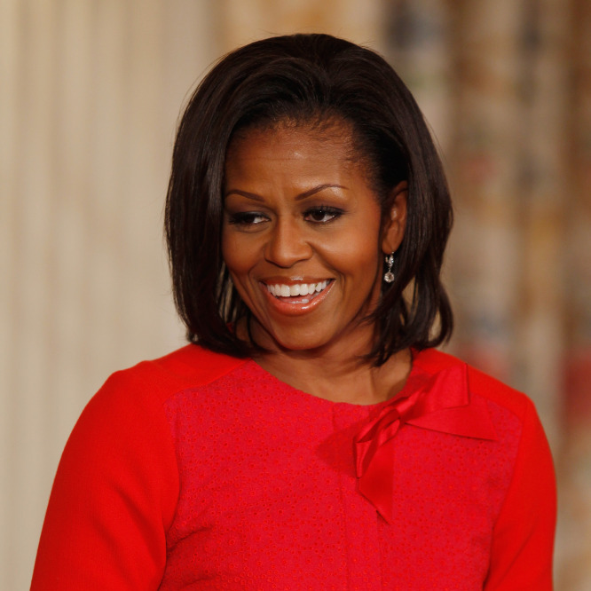 Michelle Obama shines in vivid red.