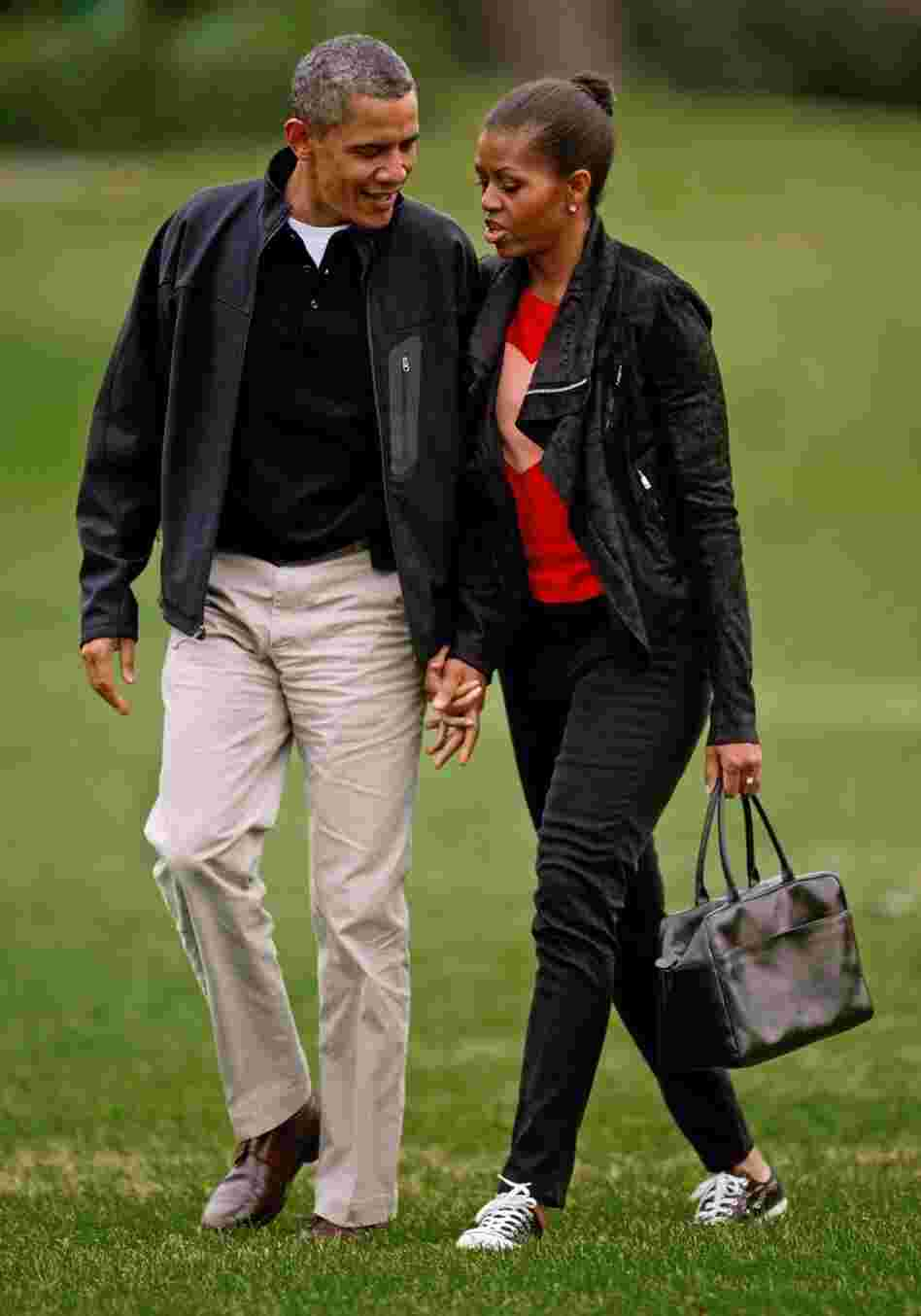 Michelle Obama sports casual skinny black pants and a matching jacket.