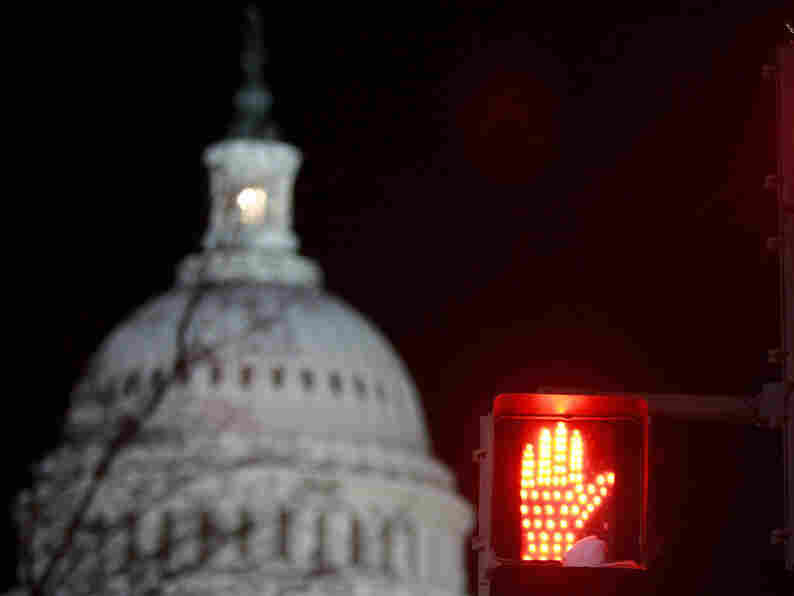 The U.S. Capitol is seen above in 2009 as senators worked late into the night on legislation. The light signifying that Congress is in session may remain on this holiday season as well, since House Republicans have said they will remain in a pro-forma session.