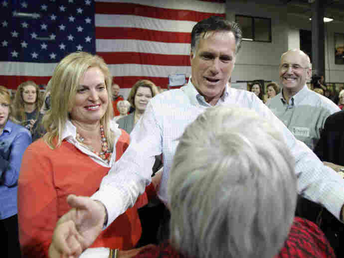 Republican presidential candidate Mitt Romney and his wife, Ann, greet crowd members while campaigning Friday in Marion, Iowa.