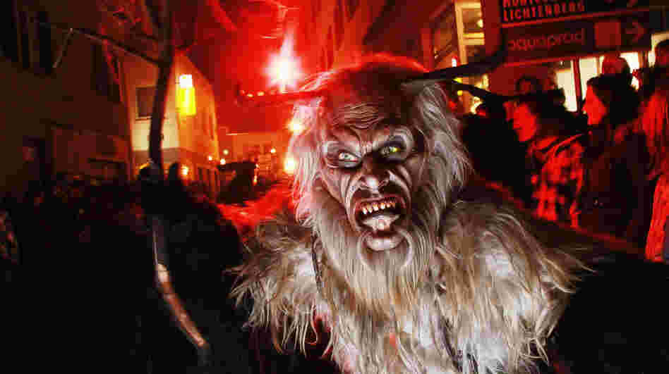 "A Krampus roams the streets during a ""Krampuslauf"" near Merano, Italy, last weekend. People around America are also taking up the European Alpine folklore tradition, dressing like the creature who steals naughty children around Christmastime."