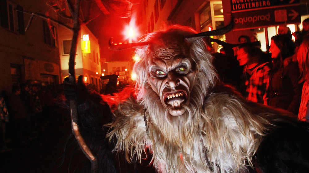 "A Krampus roams the streets during a ""Krampuslauf"" near Merano, Italy. (Source: Johannes Simon/Getty Images via NPR.com)"