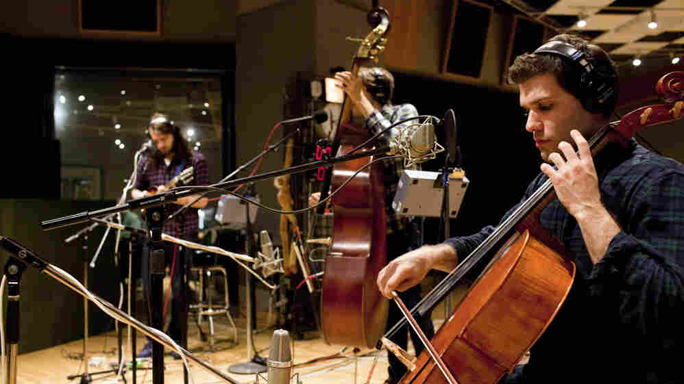 Josh Hirshfeld (mandolin), Evan Younger (double bass) and Geoff McDonald (cello) of Miracles of Modern Science settle into NPR's Studio 4A.