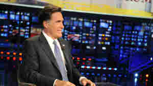 Former Massachusetts Gov. Mitt Romney appears on the Fox News program Huckabee on Dec. 3. The Republican presidential candidate has made a number of media appearances recently, mostly on Fox. He scarcely spoke to the media until the last week or so.
