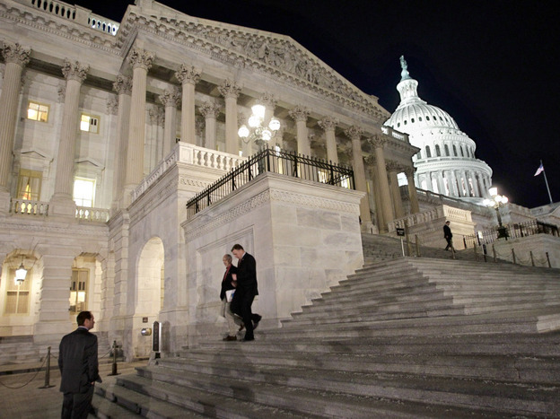 Congressmen walk down the steps of the House of Representatives as they work overnight on a spending bill in February. (AP)