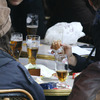 Youths drink beer in a Paris cafe.