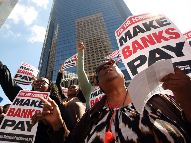 LOS ANGELES, CA - OCTOBER 6: Protesters march on downtown banks in Los Angeles, California. (Photo by David McNew/Getty Images)