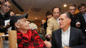 Mitt Romney greets Vietnam War veteran Bob Garon during a campaign stop at the Chez Vachon Restaurant on Monday in Manchester, N.H., where Garon, who is gay, questioned Romney about his position on gay marriage.