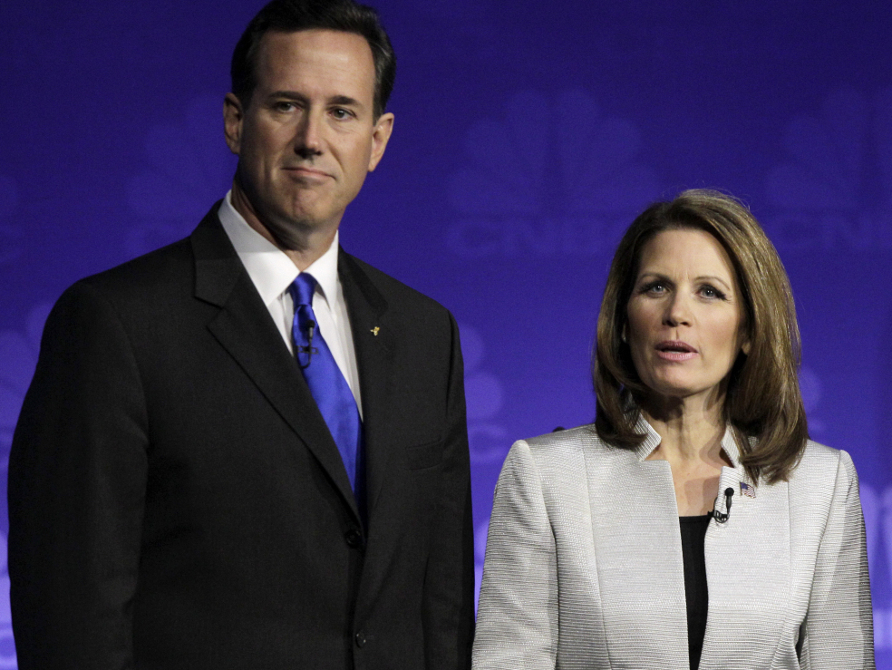 Republican presidential candidates former Pennsylvania Sen. Rick Santorum and Rep. Michele Bachmann, R-Minn., are seen before a Republican presidential debate at Oakland University in Auburn Hills, Mich., Wednesday, Nov. 9, 2011.