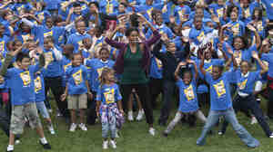 First lady Michelle Obama kicks off jumping jack world record attempt at the White House on Oct. 11, 2011.