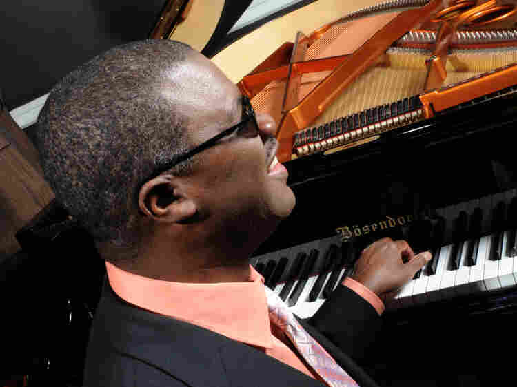 """Jazz pianist Marcus Roberts turns the exuberant """"Joy to the World"""" into a ragtime tinged with melancholy."""