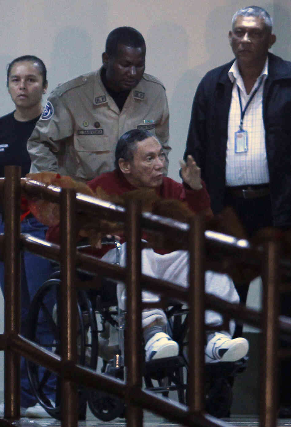Panama's ex-dictator Manuel Noriega is wheeled into a Panamanian prison on Sunday.