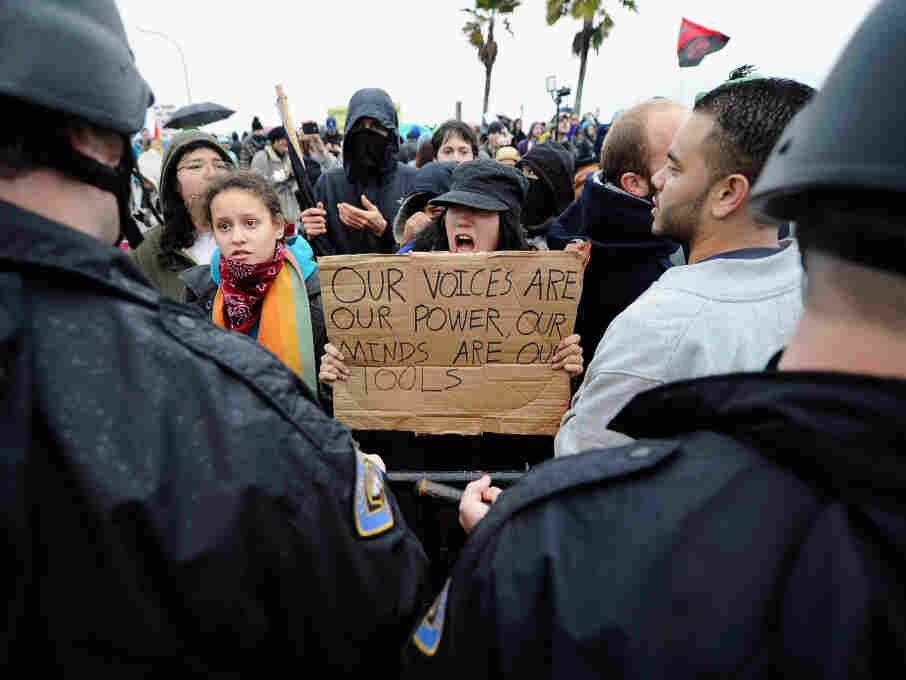 Occupy protesters clash with Long Beach Police Department officers after blocking the road leading to SSA Marine, a shipping company that is partially owned by investment bank Goldman Sachs, at the Port of Long Beach on Monday.