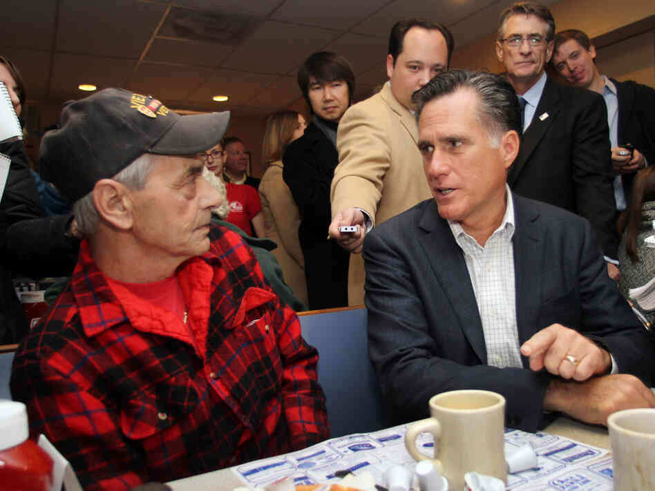 Mitt Romney talks to Bob Garon at at Chez Vachon Restaurant, Monday, Dec. 12, 2011.