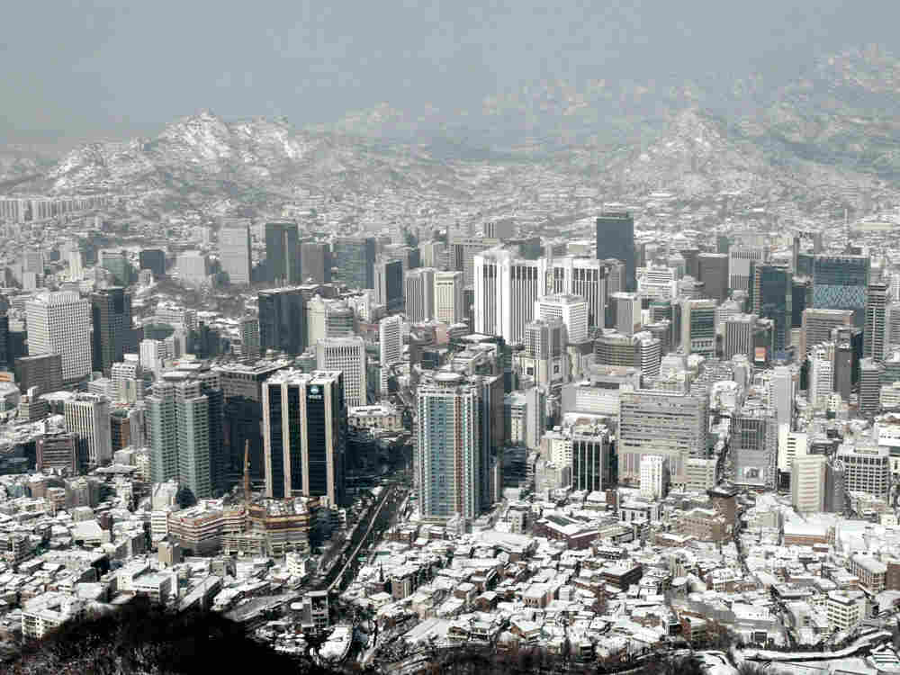 In this Jan. 5, 2010 file photo, buildings and houses are covered with snow in Seoul, South Korea. June 25, 2010 marks the 60 anniversary of the Korean War.
