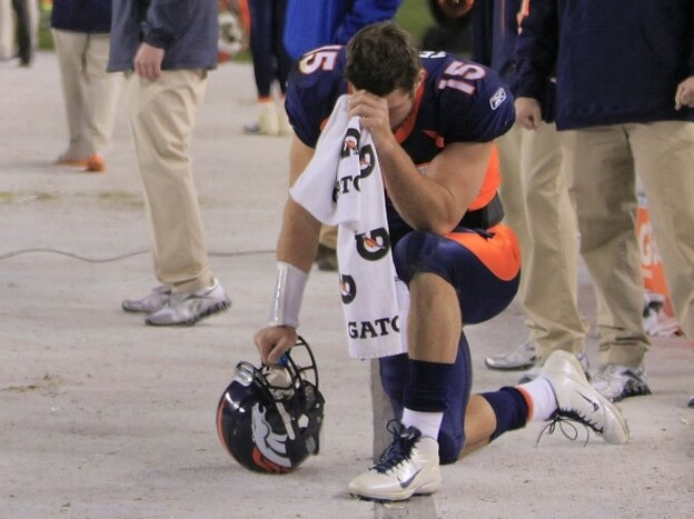 Denver Broncos quarterback Tim Tebow bows his head on the sidelines — the gesture that's been enshrined as &quot