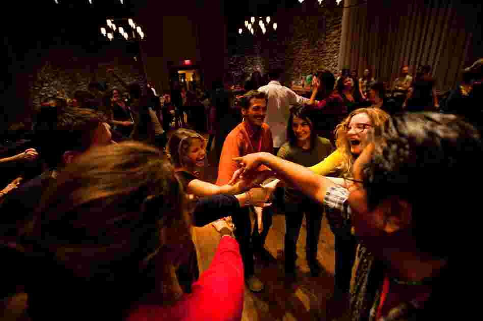 Young farmers let loose during a contra dance, a type of line-dancing.