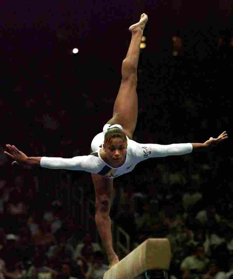 Dawes performs her balance beam routine at the Atlanta Games in 1996.