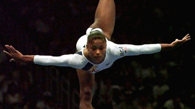 Dawes performs her balance beam routine at the Atlanta Games in 1996. (AP)