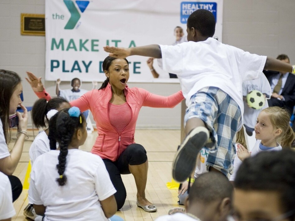 Dominique Dawes encourages kids to get 60 minutes of active play every day as part of the kick off of YMCA's Healthy Kids Day in April 2011.