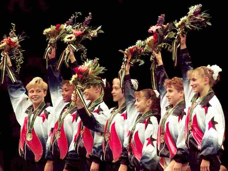 "Dawes and her teammates, known as the ""Magnificent Seven,"" wave to the crowd after being awarded their gold medals in the team competition at the 1996 Summer Games in Atlanta."