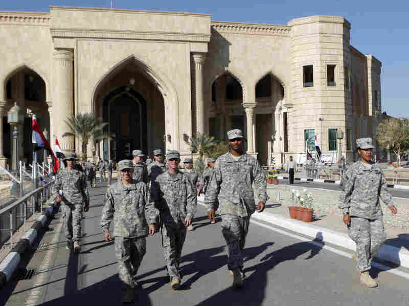 U.S. troops leave Al Faw palace at Camp Victory in Baghdad earlier this month. The complex was a significant point of logistics for the Iraq War and was recently transferred to Iraqi control.