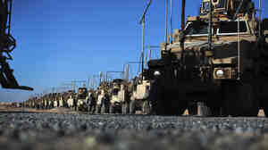 A day after leaving Iraq last week, U.S. Army soldiers from the 1st Cavalry Division lined up their armored vehicles near Kuwait City, Kuwait. Armored equipment will not stay behind after troops leave Iraq, but other property may.