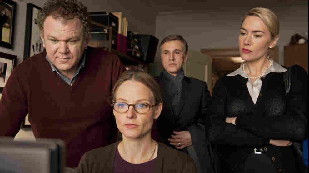 What Happened Here: Two couples (from left, John C. Reilly,  Jodie Foster, Christoph Waltz and Kate Winslet) reconstruct a playground incident that ended in bloodshed.