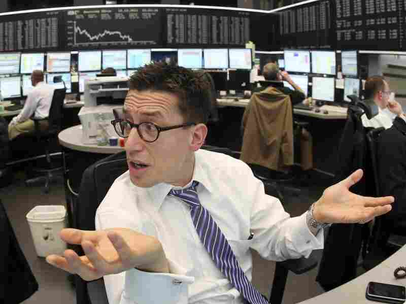 So far, European markets have not been impressed by last week's EU plan designed to fix the current crisis. Here, a trader is seen at the stock market in Frankfurt, Germany, on Monday.