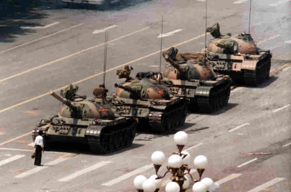 A Chinese protestor blocks a line of tanks June 5, 1989. The man, calling for an end to the violence and bloodshed against pro-democracy demonstrators at Tiananmen Square.