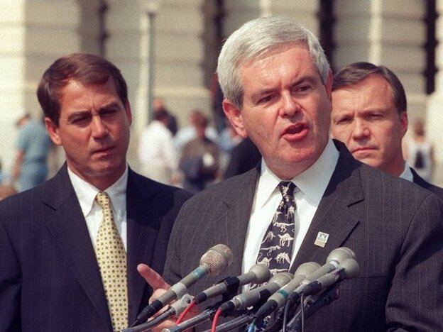 Then-House Speaker Newt Gingrich at a 1998 Capitol Hill news conference, flanked by Ohio Republican Rep. John Boehner, left (the current House speaker), and California Republican Rep. Christopher Cox.