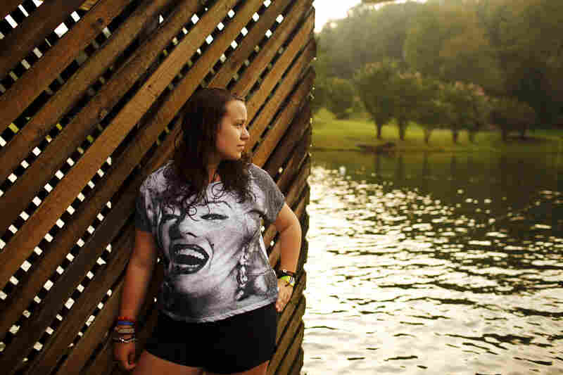 Sydney Appelbaum of Newton, Mass., poses by the lake at Wellspring in August.