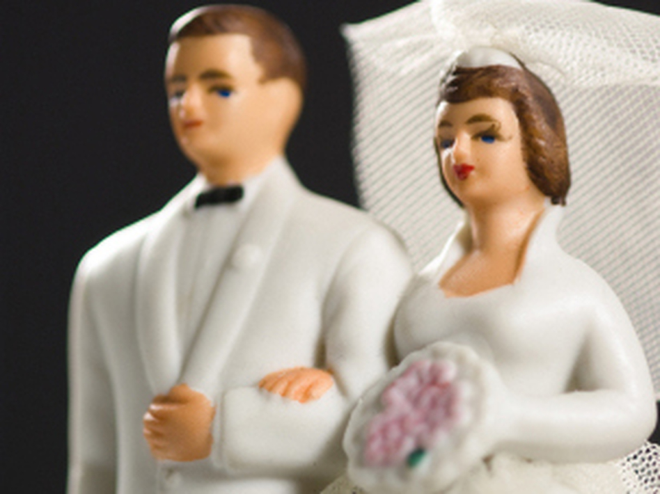 Marriage — it's so last century. A new report finds that the share of all U.S. adults who are married has dropped to its lowest on record. (iStockphoto.com)