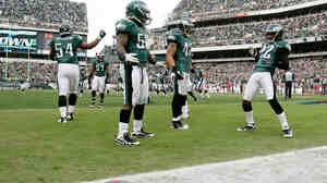 End Zone Dance: Asante Samuel (22, right) celebrates a touchdown after making an interception, as his Philadelphia Eagles teammates seem to wait for cues to the next dance steps, Nov. 13.