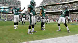 End Zone Dance: Asante Samuel (22, right) celebrates a touchdown after making an interception, as his